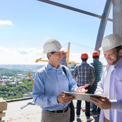 Architect Explain Project Plan To Builder Contractor On Constuction Site, Building Business Concept